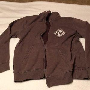 Brown zip up sweatshirt.